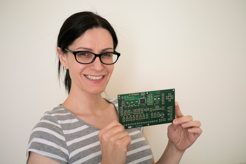 Nina Holding a Stepper Acid PCB that she designed